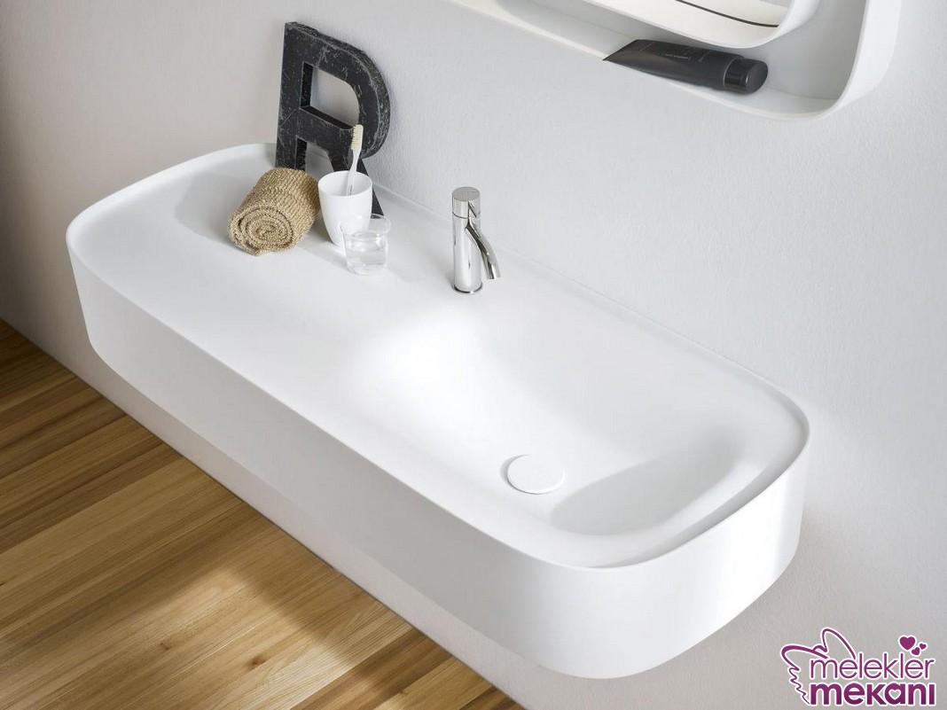 Şık banyo tezgahında oval tasarım corian banyo tezgahından faydalanabilirsiniz.